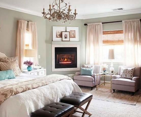 Если вы не собираетесь в спальне жарить шашлыки, то можно использовать и искусственный камин.