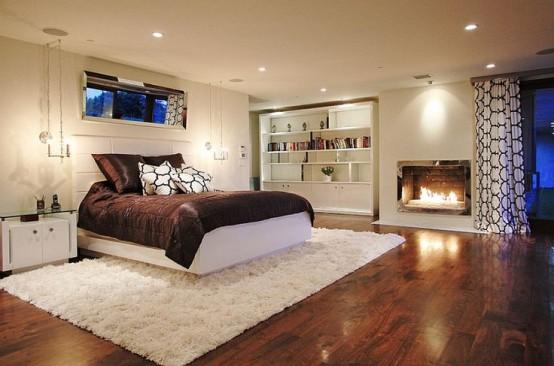Современный интерьер спальни с газовым камином.