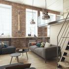 Кирпичные стены и винт аэроплана на стене подчеркивают принадлежность интерьера квартиры к стилю лофт.