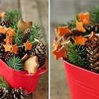 Рождественская экибана украшенная гирляндой звездочек из мандариновых шкурок.