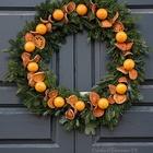 Рождественский венок украшенный ломтиками и целыми апельсинами. (новый год,рождество,декор,цитрусовые,лимон,апельсин,мандарин,ёлка,сделай сам,самоделки,интерьер,дизайн интерьера)