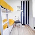 Гостевой дом. Маленькая спальня с двуспальной кроватью.