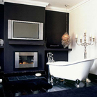 Когда камина не достаточно можно установить телевизор, чтобы иметь возможность посмотреть любимый фильм сидя в ванне.