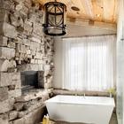 Ванная комната в рустикальном стиле с камином выложенным гранитом.