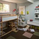 Детская комната. Высокая кровать хорошо подошла к высокому окну.