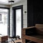 Сауна - достаточно традиционное помещение для финских домов, поэтому ее присутствие в этом доме не удивительно. (скандинавский,современный,архитектура,дизайн,экстерьер,интерьер,дизайн интерьера,мебель,ванна,санузел,душ,туалет,дизайн ванной,интерьер ванной,сантехника,кафель)