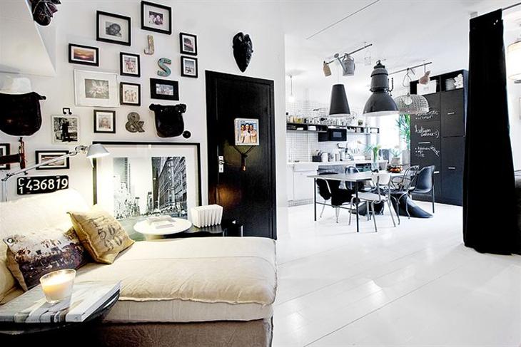 Фотографии и маски на стене над диванчиком привносят в дом индивидуальности заполняя дом воспоминаниями и эмоциями.