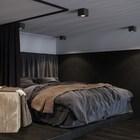 Второй уровень квартиры позволил сделать полноценную спальню с большой квартирой.