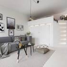 В нише  в глубине комнаты установлен шкаф-кровать. (скандинавский,интерьер,дизайн интерьера,мебель,квартиры,апартаменты,гостиная,дизайн гостиной,интерьер гостиной,мебель для гостиной,спальня,дизайн спальни,интерьер спальни)