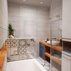 Интерьер ванной, в целом, построен на контрасте холодных серых оттенков и теплых древесных фактур столешниц и полок. (квартиры,апартаменты,мебель,интерьер,дизайн интерьера,скандинавский,ванна,санузел,душ,туалет,дизайн ванной,интерьер ванной,сантехника,кафель)