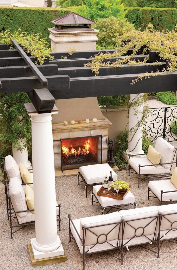 Поскольку терраса является комнатой на свежем воздухе, то почему там не сделать камин?
