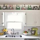 Над шкафами часто остается место которое можно использовать для хранения того чем не пользуешься очень часто.
