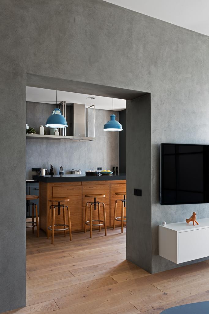 Серые оштукатуренные стены - это именно то чего ожидаешь от интерьера в стиле лофт.