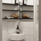 Небольшой туалет с таким же крохотным угловым умывальником. (квартиры,апартаменты,скандинавский,минимализм,интерьер,дизайн интерьера,мебель,ванна,санузел,душ,туалет,дизайн ванной,интерьер ванной,сантехника,кафель)