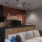 Барная стойка отделяет кухню от гостиной, одновременно объединяя жилую комнату в общую экосистему. (индустриальный,лофт,винтаж,стиль лофт,индустриальный стиль,квартиры,апартаменты,интерьер,дизайн интерьера,мебель,кухня,дизайн кухни,интерьер кухни,кухонная мебель,мебель для кухни,гостиная,дизайн гостиной,интерьер гостиной,мебель для гостиной,столовая,дизайн столовой,интерьер столовой,мебель для столовой,жилая комната)