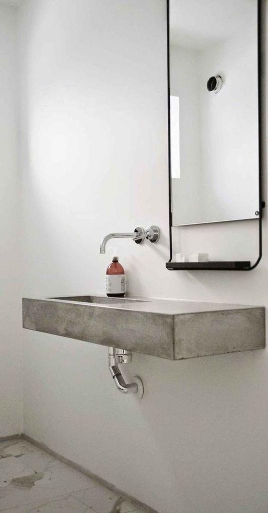 Бетонный умывальник идеально подойдет для минималистского интерьера или интерьера в стиле лофт.