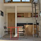 Открытая кухня первого этажа. На второй этаж ведет компактная лестница. (маленький дом,архитектура,дизайн,экстерьер,интерьер,дизайн интерьера,мебель,минимализм,индустриальный,лофт,винтаж,стиль лофт,индустриальный стиль,кухня,дизайн кухни,интерьер кухни,кухонная мебель,мебель для кухни,спальня,дизайн спальни,интерьер спальни)