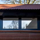 Стены и крыша из профнастила, окна из спальни.