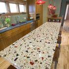 Бетонная полированная столешница для кухонного острова из светлого бетона с добавлением разноцветного стекла и камня.