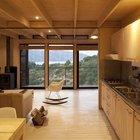 Для отопления в гостиной дома предусмотрена дровяная металлическая печь.