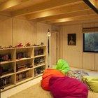 Медиа комната или игровая удобно расположена рядом с двумя детскими спальнями. (архитектура,дизайн,экстерьер,интерьер,дизайн интерьера,мебель,минимализм,современный,кинозал,медиа комната,кинотеатр)